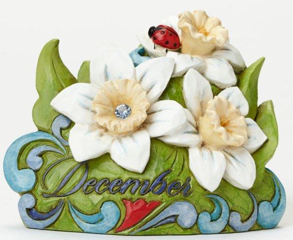 Jim Shore 4040666 December Flower Nar Figurine
