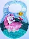 Kubla Crafts Soft Sculpture KUB 8801 Baby Bunny in a Carriage Bib